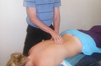 Woman Getting A Treatment From A Chiropractic Specialist