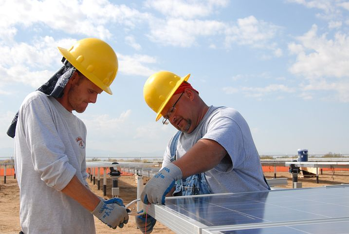Two workers offering commercial solar financing