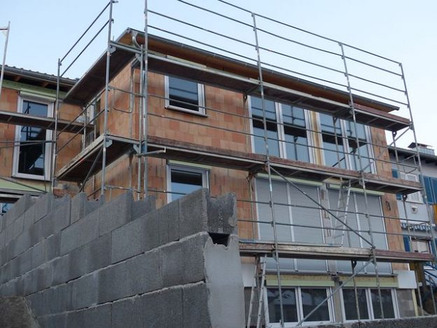 scaffolding surrounding a building being constructed